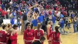 South Dakota State players and fans celebrate after the Jackrabbits beat USD 83-71 on Tuesday.