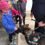 The police dogs came from all across the state to put a smile on Emma Mertens' face.