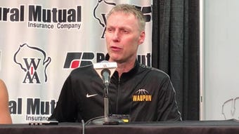 Waupun coach Dan Domask talks about the WIAA Division 3 state semifinal win over Denmark on Thursday at the Kohl Center in Madison.