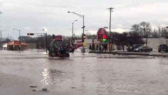 At Johnson and Seymour streets in Fond du Lac, people are being rescued from their flooded homes in front end loaders.