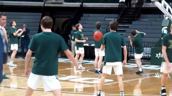 Pregame video of Howell boys basketball warming up before game against Ypsilanti Lincoln in the state boys' basketball semifinals at the Breslin Center.