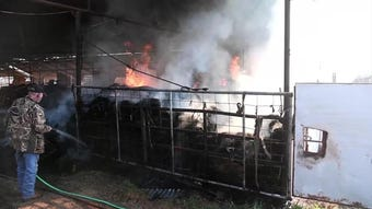 Hay bales on fire in barn on Pecanway Drive Monday morning.