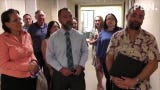 Sens. Telo Taitague and Clynt Ridgell join officers of the 452-strong Guam Association of Realtors Wednesday morning in hand-delivering a formal request to the Guam Public Utilities Commission to consider applying residential power rates to those living in multi-dwelling buildings such as apartments