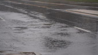 Water is starting to collect along roads in Newark on Kirkwood Highway as heavy rains pass through the area on Thursday afternoon.