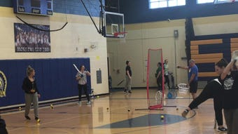 Maine-Endwell's softball team, three-time defending Class A state champs, practices Friday in the high school gym.
