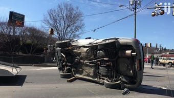A car that was overturned following a two-vehicle accident Ithaca intersection is flipped upright. No injuries were reported in the crash.