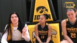 Seniors Megan Gustafson, left, and Tania Davis, center, describe their differing paths during their time at Iowa.
