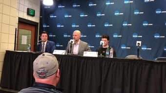 St. Cloud State men's hockey coach Brett Larson gives an opening statement after a 2-1 loss to American International at the West Regional in Fargo,.