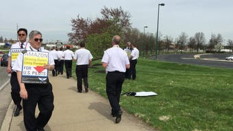 Pilots of three cargo airlines who fly DHL and Amazon Prime Air protested April 11 outside Atlas Air near CVG for higher wages and a new contract.