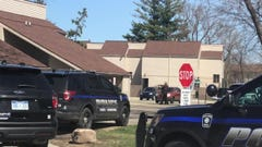 Police surround Meridian Twp. home