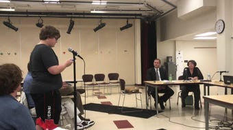 Five individuals, including three Utica High School students, addressed to the North Fork school board, supporting English teacher Brian Gastin.