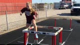 Henderson County's Isabella Tichenor is unbeaten in the 100 and 300 hurdles. Her training is one of the reasons for her success, she says.