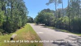 Escambia County plans to auction land in this quiet waterfront neighborhood on April 24-29.