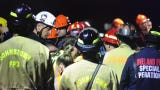 First responders worked nearly seven hours trying to save the two men buried in a 15-foot trench at a new housing development.