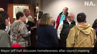Citizens who want the city to do more to address homelessness in Newark confront Mayor Jeff Hall following the city council meeting.