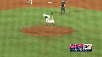 Blue Wahoos pitcher Dusten Knight performs a celebratory backflip after closing out game.