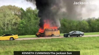 A moving truck is engulfed in flames on the shoulder of Interstate 40 East on Wednesday.