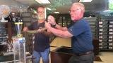 "Reptile World Serpentarium owner George Van Horn and David Bledsoe, exhibit curator, milk two rattlesnakes during an April 17 ""venom show."""