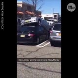 Think you're having a bad day? What about when someone drives their car onto your car in the Bergen Town Center parking lot?
