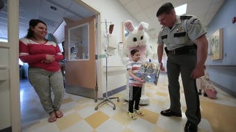 El Paso Sheriff Richard Wiles, several deputies and the Easter Bunny visit El Paso Children's Hospital to deliver Easter baskets.