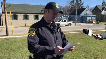 Seymour police public information officer Brett Stauber addresses the media after three people, including two children, were found in a residence.