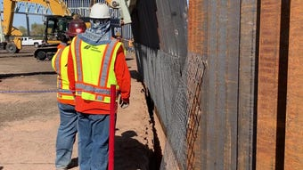 Fisher Industries demonstrates a border wall prototype in Coolidge, Ariz. for members of Congress.