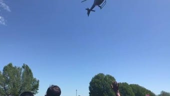 Approximately 2,000 people gather at High Street Baptist Church April 21, 2019 as a helicopter piloted by Josh Dalley drops 10,000 Easter eggs.
