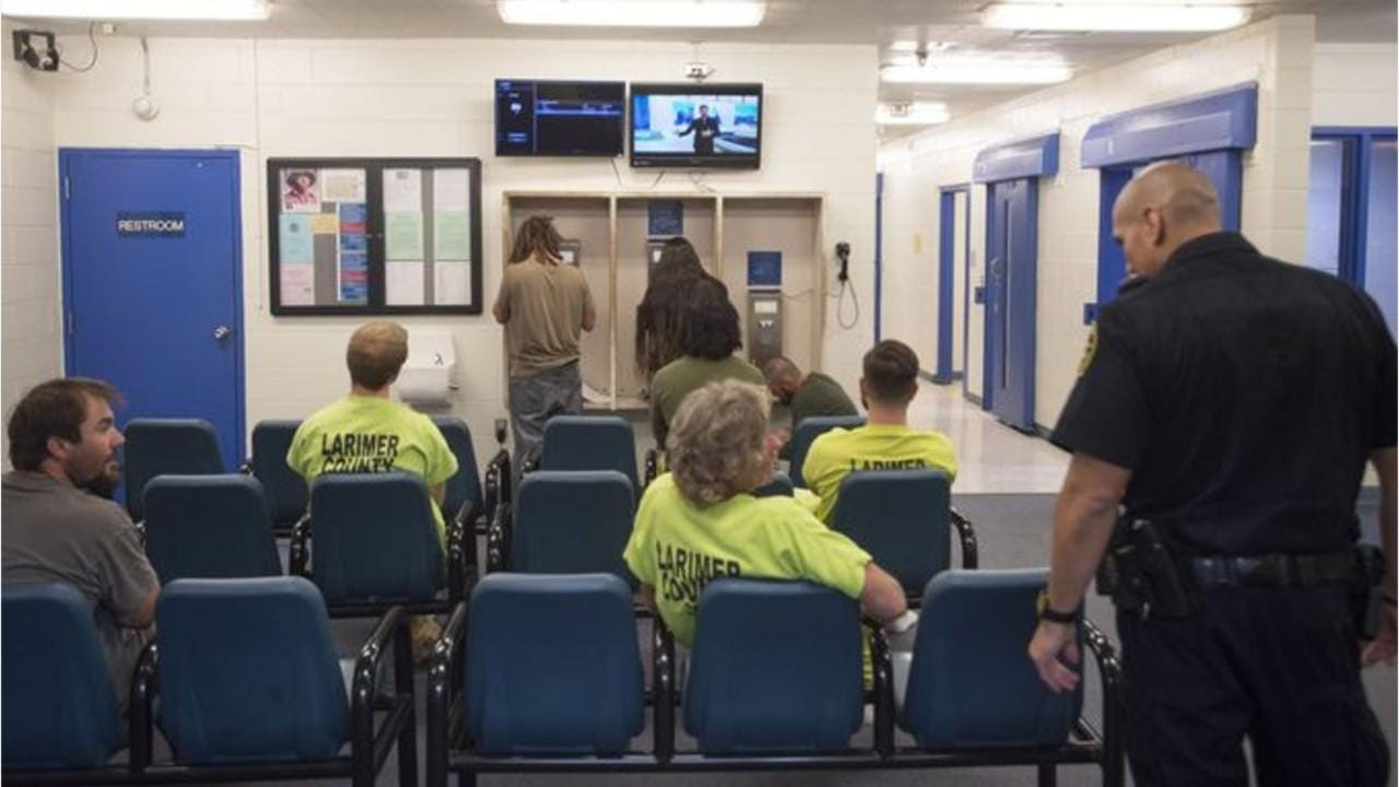 What happens when someone is booked into Larimer County Jail?