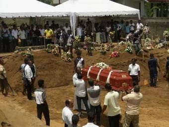 As Sri Lanka's leaders wrangled with the implications of an apparent militant attack and massive intelligence failure, security was heightened Tuesday for a national day of mourning. (April 23)