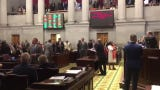 The house holds a tied vote open on the school voucher bill.