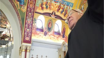Art painted on the ceiling of Livonia's St. Mary's Basilica Orthodox Church. Father George Shaloub leads a quick tour of the greek artist's work.