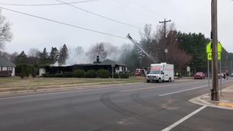 A Schofield home smolders as fire departments from across the Wausau area work to extinguish hot spots.