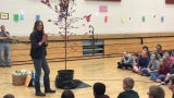 Connie Miller of the Coshocton Tree Commission talks about a prairie fire crab apple tree with Coshocton Elementary sixth-graders.