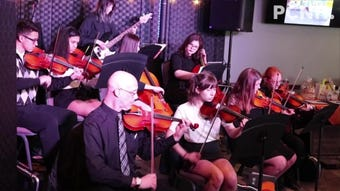 The nationally-recognized Port Clinton High School Chamber Orchestra performs at the GPCAAC's Mello Cellos fundraiser on Tuesday.