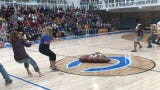 Carlsbad seniors compete against staff members in a tug-of-war to end the final spring pep rally of the year.