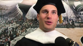 Minnesota Vikings QB Kirk Cousins received an honorary doctorate of humanities Friday before giving Michigan State's commencement speech.