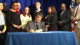 The law, guaranteeing 40 hours of paid time off for domestic abuse victims, is signed by Westchester County Executive George Latimer on May 3, 2019.
