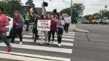 """Build the Bridge"" rally held at the intersection of US 41 and Washington Avenue by student and community activists who want an overpass built."