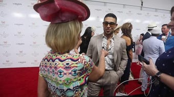Wilmer Valderrama talks with Kirby Adams on the red carpet at Churchill Downs.