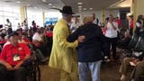 A zoot suited greeter dances with veteran Army nurse Maryrose Troniar as the Collier-Lee Honor Flight awaits the return trip to Southwest Florida Saturday afternoon, May 4, 2019.