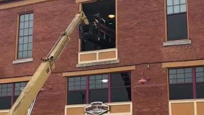 Watch: 2,000-pound grill extracted from third-story window