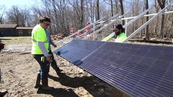 The Green Panel installs solar panels at a home under construction.
