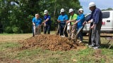 Loaves & Fishes board members break ground on their new facility on Crossland Avenue on Wednesday, May 8, 2019