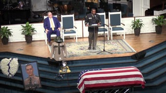 Tennessee Highway Patrol Cpt. Jimmie Johnson speaks at Tennessee State Trooper Matthew Gatti's funeral.