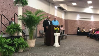 Abilene High assistant athletic director Bobby Black is the butt of a joke by Cooper High teacher Jimmy Pogue before being recognized for 50 years at AISD