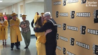 Emma West hadn't seen her brother, Blake, in nearly three years until Saturday, when he greeted her with a surprise photobomb before her graduation.