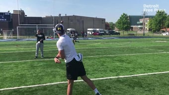 Michigan 2021 QB commit J.J. McCarthy (La Grange Park, Ill.) does drills, including one borrowed from a play made by Aaron Rodgers, May 18, 2019.