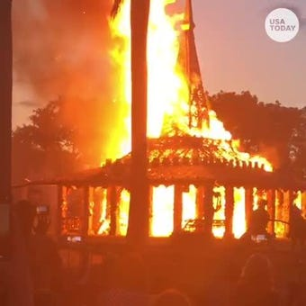Hundreds watch the Temple of Time burn in a ceremonial fire on May 19, 2019 in Coral Springs. The temporary temple was built by artist David Best and more than 500 volunteers and opened on Feb. 14, a year after the shooting at Marjory Stoneman Douglas High in Parkland, Florida.