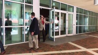 VR case defendant John G. Williams Jr. exits federal court. He was sentenced to 2 1/2 years in prison