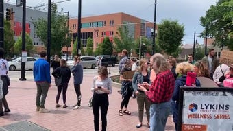 Protesters make their voices heard at the Stop the Bans rally at Cincinnati's Washington Park Tuesday, May 21, 2019.